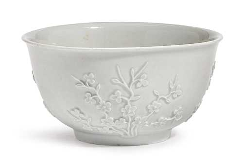A BOWL WITH RELIEF FLOWERS