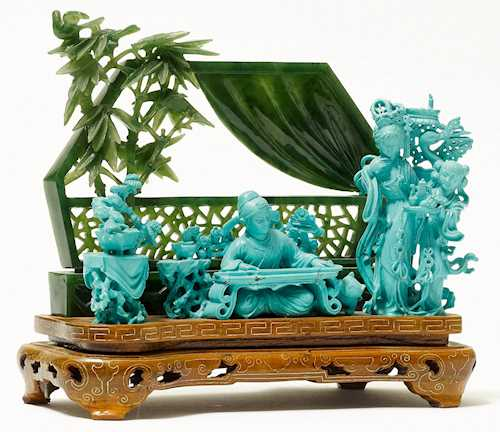 A FINE CARVING WITH QIN PLAYER.