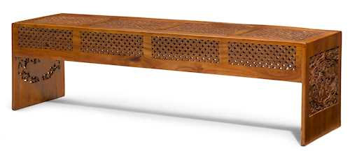 A CARVED WOOD BENCH.