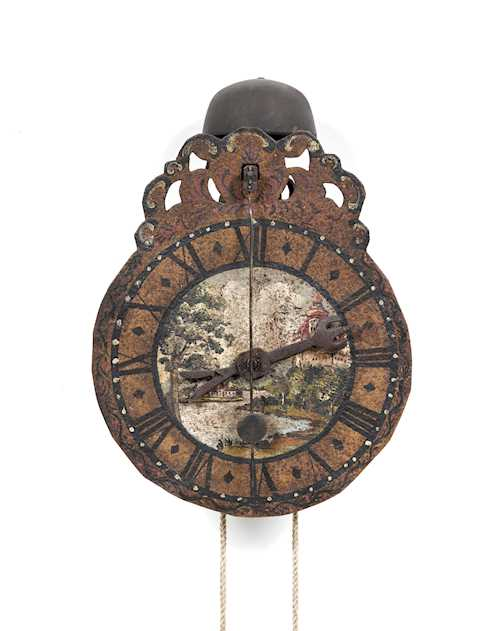 IRON CLOCK WITH FRONT PENDULUM