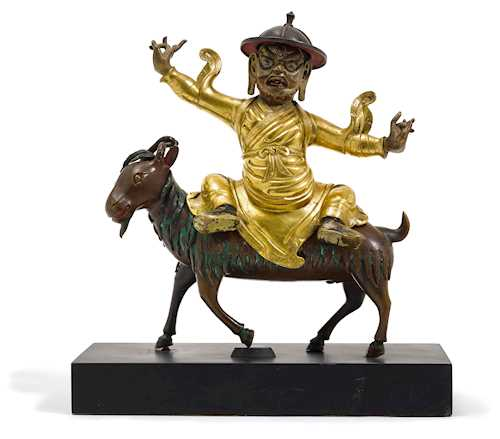 A PARTLY GILT COPPER REPOUSSE FIGURE OF DAMCAN.