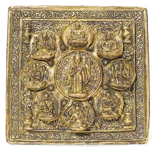 A REPOUSSE GILT COPPER MANDALA.