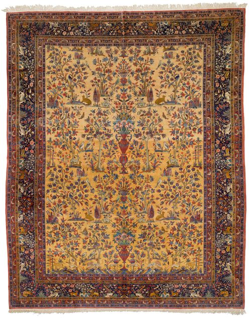 KESHAN antique.Yellow central field, finely patterned with plants and animals in harmonious colours, dark blue edging, in good condition, 315x410 cm.