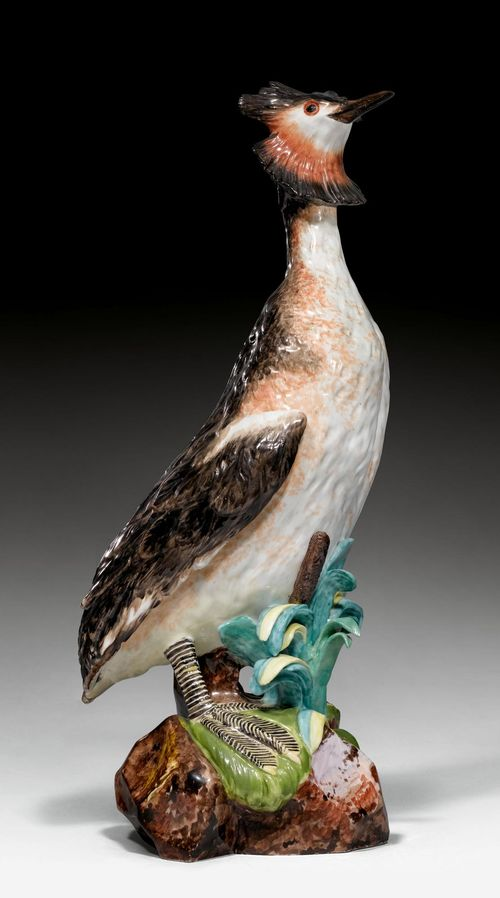 RARE MODEL OF AN 'AUGUSTUS REX' GREAT CRESTED GREBE,Meissen, model by Johann Joachim Kändler, ca. 1734. Naturalistically modelled. Blue AR monogram on the unglazed base. H 48 cm. Restoration on both feet, beak and reed leaves, small chip on head feathers. Provenance: - From the Royal Collections, Friedrich August II. Elector of Saxony, King August III. (1696-1763), Dresden. - Gut Aabach, Risch am Zuger See.