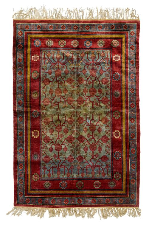 SAMARKAND SILK antique.Turquoise central field patterned throughout with pomegranates in shades of red, wide border in blue and red, in good condition, 160x225 cm.