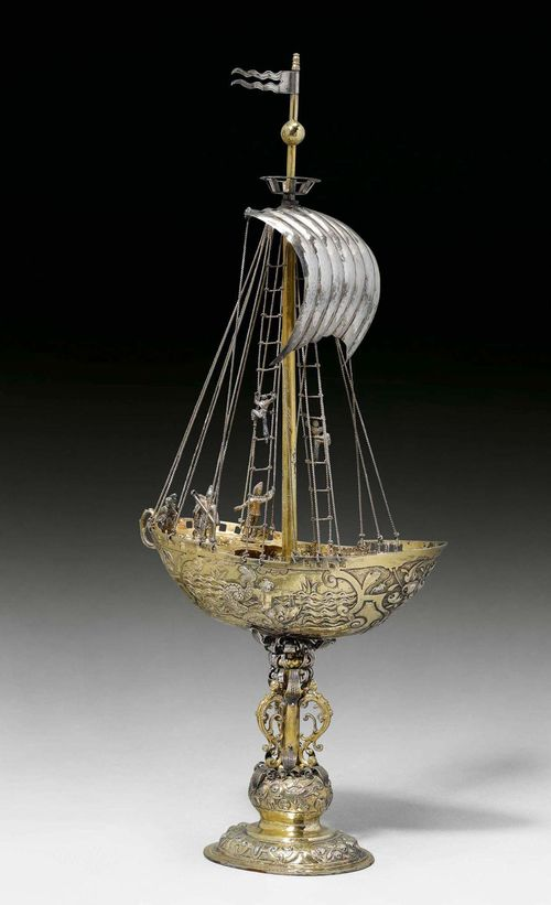 DRINKING VESSEL, Augsburg 1600-1610. Maker's mark: Heinrich Winterstein. Parcel-gilt. The sails and flags in silver. H 40 cm, 460g. Provenance: - Fritz Payer TEFAF, Maastricht 2003. - German private collection.