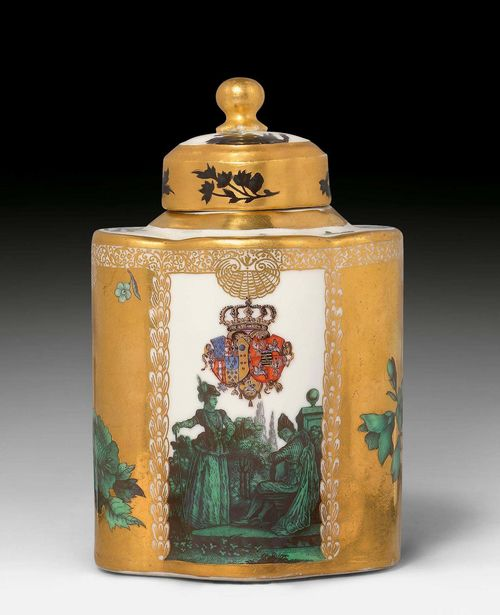 IMPORTANT MEISSEN ARMORIAL TEA CADDY FROM THE TOILETRY SERVICE FOR QUEEN MARIA AMALIA OF NAPLES AND SICILY, PRINCESS OF SAXONY, Meissen, ca. 1745-46. Decorated by Gottlob Siegmund Birckner, 'glazed' with copper-green Watteau scenes. Scenes from an Italian comedy. The front with the coat-of-arms of Naples-Sicily and Saxony-Poland. H 13.5 cm. Small hairline crack in the cover, retouched. Signs of a blue sword mark. Provenance: - from the toiletry service for Maria Amalia, Queen of Naples and the Two Sicilies, a present from her mother, Maria Josepha, Electress of Saxony (1699-1757). - from a Zurich private collection.