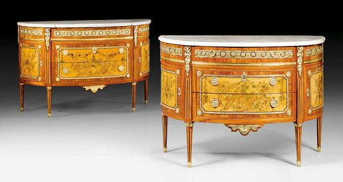 "PAIR OF DEMI-LUNE CHESTS OF DRAWERS WITH FLORAL MARQUETRY,Louis XVI, stamped C. TOPINO (Charles Topino, maitre 1773), guild stamp, Paris circa 1775/80. Tulipwood, amaranth and partly dyed precious woods in veneer, with exceptionally fine inlay of floral garlands, fillets and frieze. The demi-lune chests with slightly salient angles and fluted columnar legs, 2 sans traverse drawers under a narrower top drawer, and 1 door at each side. Decorated with exceptionally fine matte and polished gilt bronze mounts, applications and sabots and with a shaped ""Carrara"" top. 142x58x87 cm and 130x60x88 cm. Provenance: from a German collection ."