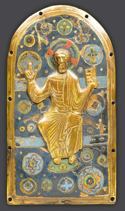MAJESTAS DOMINI,Limoges, beginning of the 13th century. Finely engraved bronze plaque with champlevé enamel and embossed and gilt copper. With an applied, embossed and gilt copper figure of Christ enthroned. 24.5x13.5 cm. Some losses.