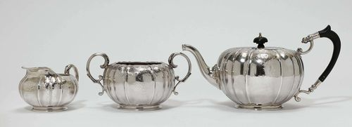 TEA SET, Birmingham 1894/95. Maker's mark: E & Co. Ltd. Comprising: tea pot, cream jug and sugar bowl. Rounded vessels on a round stand. Volute handles with leaf decoration. Sugar bowl with engraving on both sides, initials and date: April 7. 1894. On the base: numbered 18752. H of the teapot 14 cm, total weight 1240 g.
