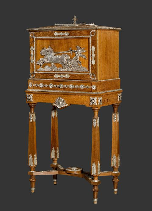 "CHARLES GUILLAUME DIEHL (1811-1885) CABINET ""A CIGAR"", circa 1870 Oka and silvered bronze. Drawer and doors at the front. Interior with 5 drawers with caned bases for cigars, Empire style silver-plated bronze mounts featuring Apollo in chariot. Lock signed Diehl Paris. H. 130 cm. L. 60 cm. T. 39 cm."