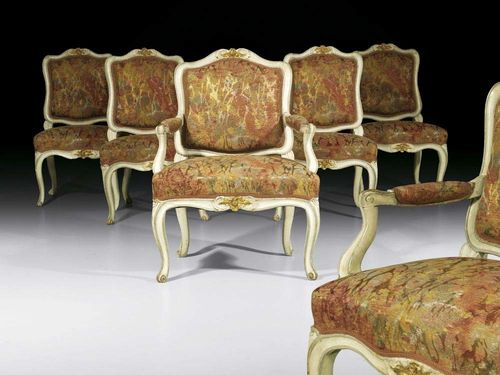 "PAINTED SUITE, Louis XV, German, 18th century Comprising: 1 pair of Fauteuils and 4 chairs ""à la reine"". Moulded and carved wood, also painted grey and parcel gilt, upholstered with polychrome silk covers. Fauteuils 62x43x44x90 cm, chairs 53x45x42x88 cm. Provenance: from a German collection"