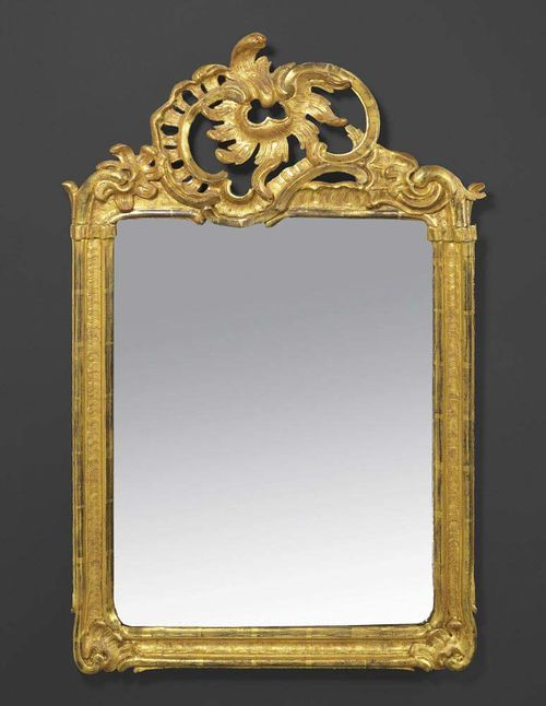 MIRROR, Louis XV, by J.F. FUNK (Johann Friedrich Funk, 1706 Bern 1775), Bern circa 1755/60. Pierced and carved giltwood. H 94 cm, W 57 cm. Provenance: Private collection, Switzerland. A fine mirror in good condition.