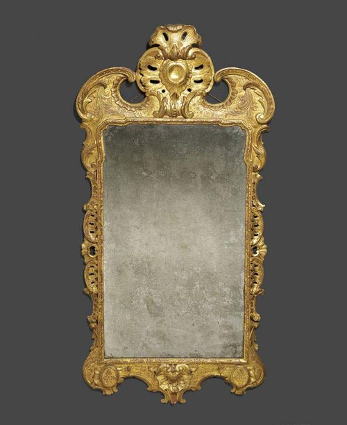 MIRROR, George I, England circa 1720. Pierced and finely carved wood and stucco, with remains of old gilding. H 155 cm, W 74 cm. Provenance: - Christie's London on 7.7.1994 (Lot No 158). - Private collection, Geneva.