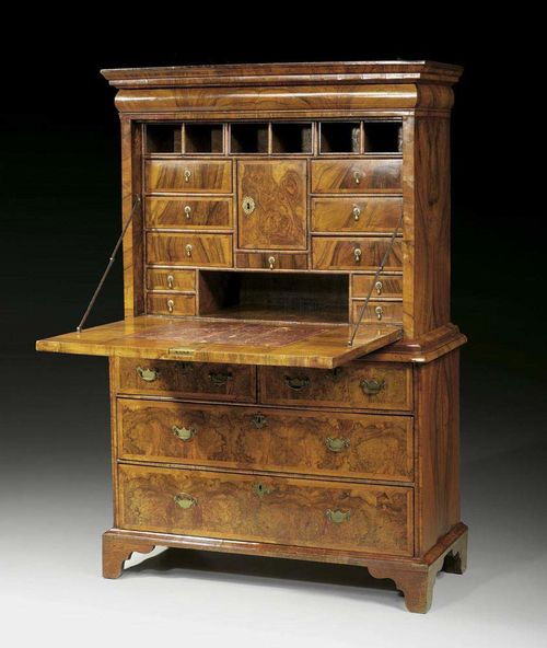 "SECRETAIRE WITH ""CUSHION DRAWER"" George I, England circa 1710/30. Walnut and burlwood, moulded and in veneer, inlaid with fine fillets. Leather lined fall front writing surface over narrow drawer  and 3 further drawers, the upper drawer divided into two. The fitted interior with central compartment, drawers and sliding compartments and secret compartments. Brass mounts and drop handles. 112x49x(open 107)x169 cm. Provenance: Private collection, Lugano."