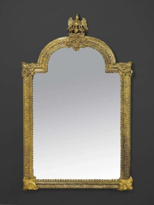 "LARGE MIRROR ""A L'AIGLE"", late George III, probably England, 19th century Gilt bronze and brass, relief decorated with eagles, putti, leaves and cartouches.  Restored.  H 103 cm, W 58 cm. Provenance: Private collection, Belgium."
