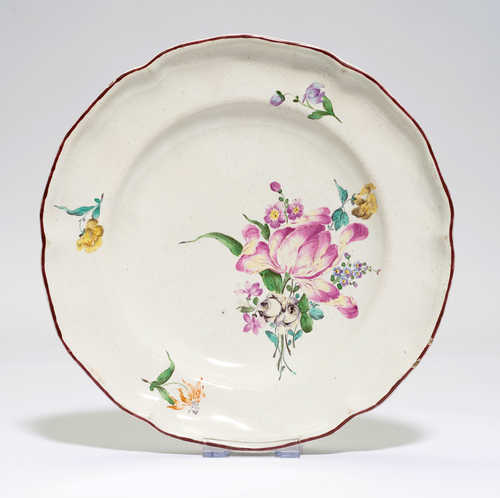 FAIENCE PLATE PAINTED WITH FLOWERS,