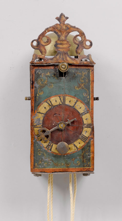 IRON CLOCK WITH FRONT PENDULUM,