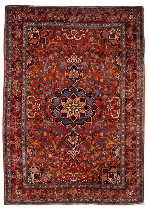 BACHTIAR old.Red ground with a central medallion, patterned with large trailing flowers and palmettes, red edging with trailing flowers, slightly restored in some areas, 305x445 cm.