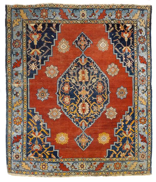 BIDJAR antique.Red ground with dark blue central medallion and corner motifs, patterned with stylized plant motifs, light blue border with trailing flowers, 145x175 cm.