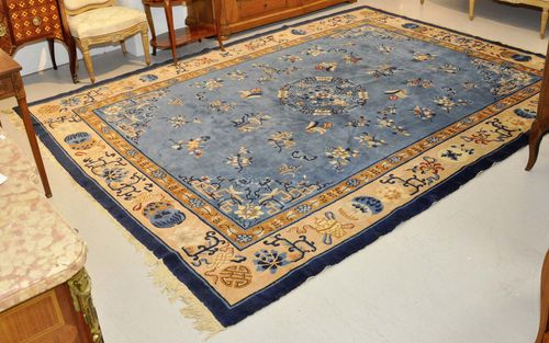 CHINA old.Blue central field decorated with floral motifs, yellow border, 250x325 cm.