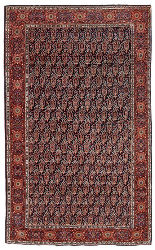 FERAGHAN old.Dark blue central field patterned throughout with boteh motifs in pink and green, rust coloured edging with stylized blossoms, 125x195 cm.