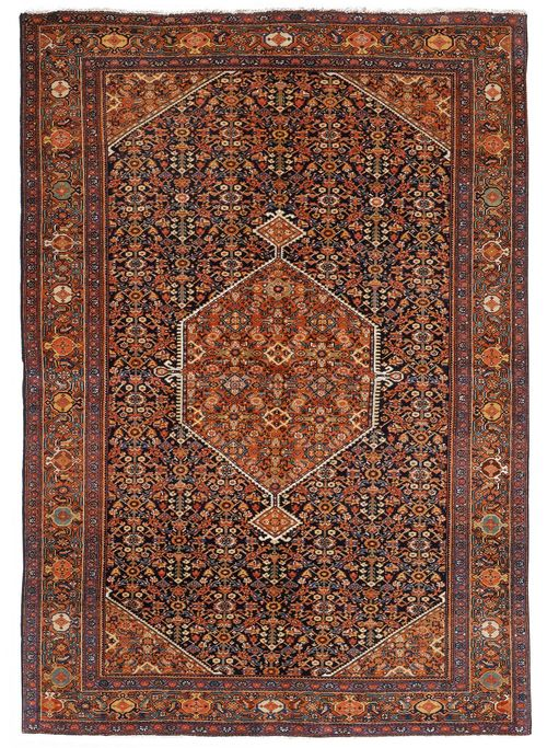 FERAGHAN antique.Black central field with a rust coloured central medallion, herati pattern in pink and green, rust coloured edging, 133x202 cm.