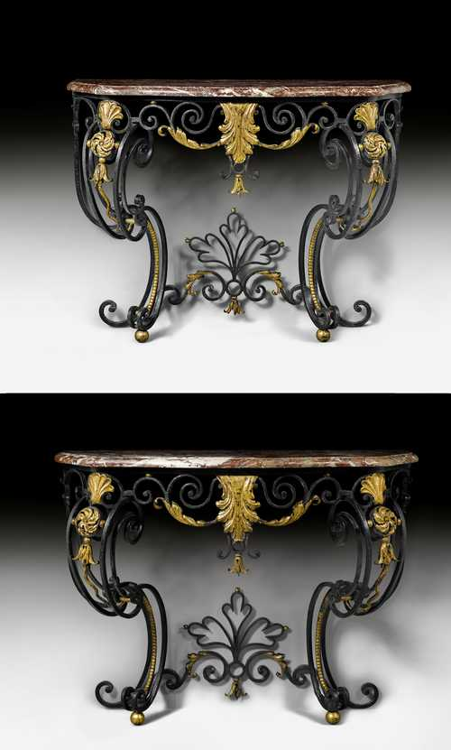 "PAIR OF IRON CONSOLES ""AUX CARTOUCHES"","