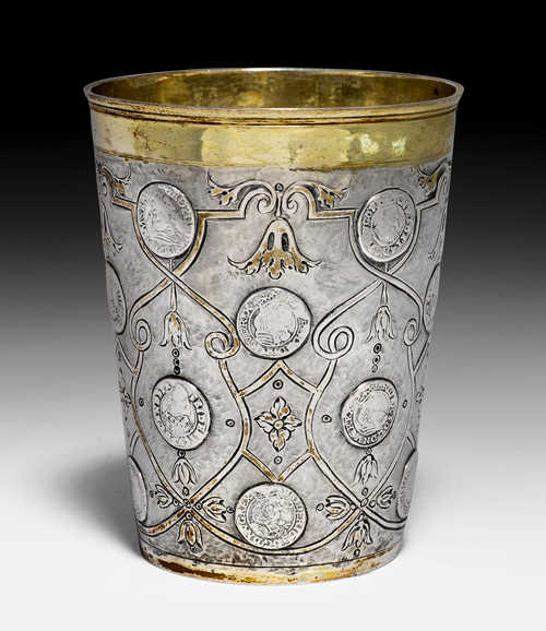 LARGE BEAKER WITH COINS,