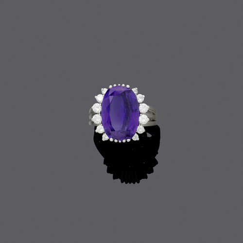 TANZANITE AND DIAMOND RING, ca. 1980.
