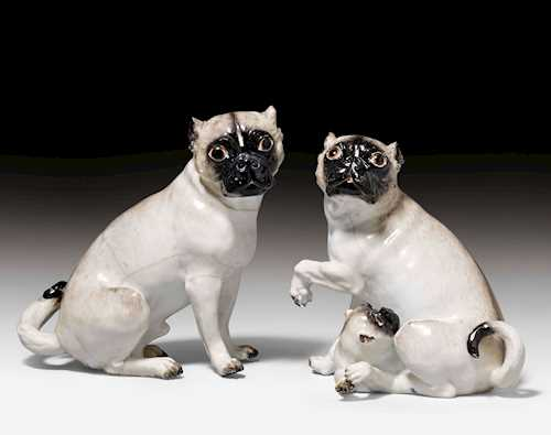 PAIR OF PUGS WITH PUPPY,