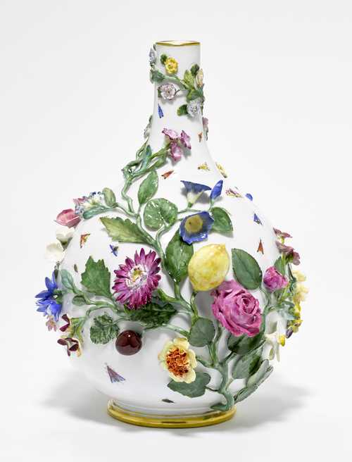 An ORNAMENTAL VASE WITH APPLIED FLOWERS AND FRUIT,