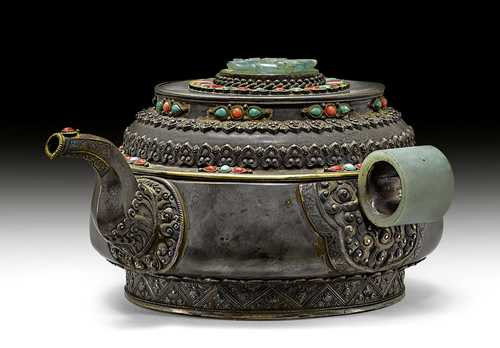 A SILVER TEA POT DECORATED WITH JADE CARVINGS.