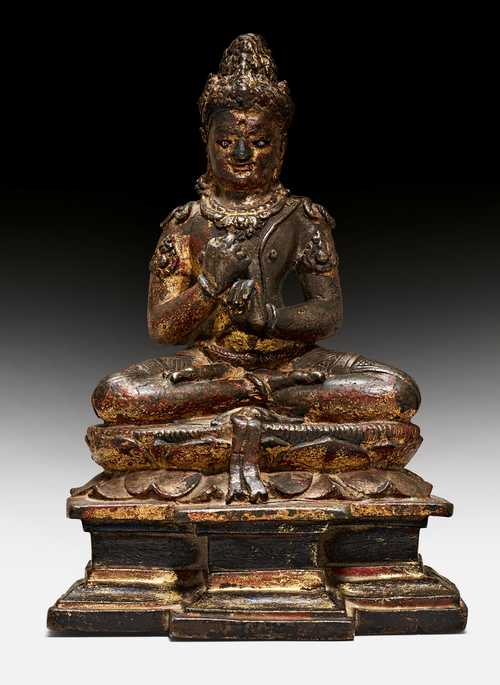 A RARE BRONZE FIGURE OF MAHAVAIROCANA.