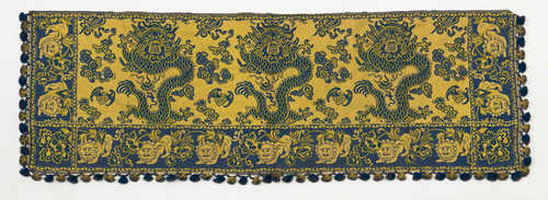 A YELLOW AND BLUE JACQUARD TABLE HANGING.