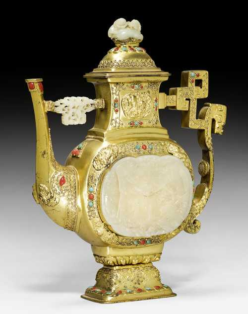 AN IMPRESSIVE GILT SILVER EWER WITH JADE OVERLAYS.
