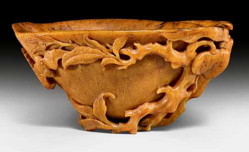 "A FINELY CARVED RHINOCEROS HORN ""BAT AND PEACHES""-LIBATION CUP."