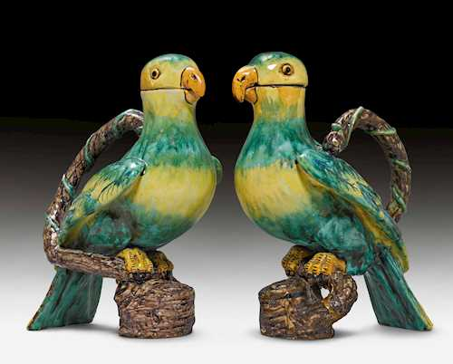 THREE FAIENCE JUGS IN THE SHAPE OF PARROTS, WITH HANDLES,