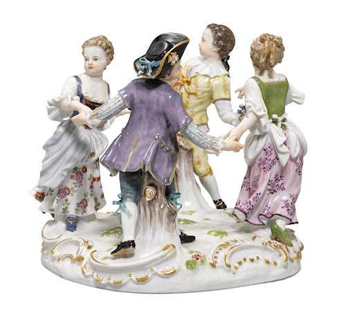 A FIGURE GROUP OF DANCING CHILDREN,