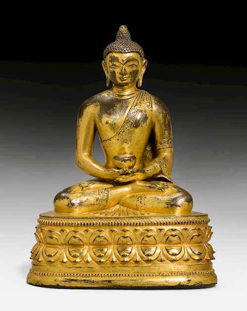 A GILT COPPER ALLOY FIGURE OF AMITHABA.