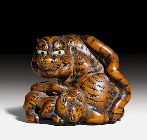 NETSUKE OF A SEATED TIGER AND CUB.