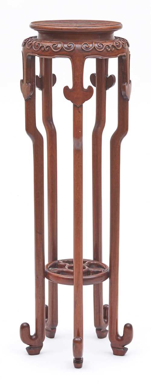 A HARDWOOD PLANT STAND.