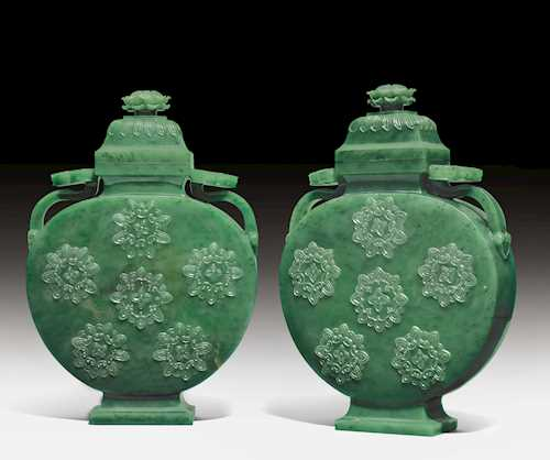 A PAIR OF FINELY CARVED MOON FLASKS AND COVERS.
