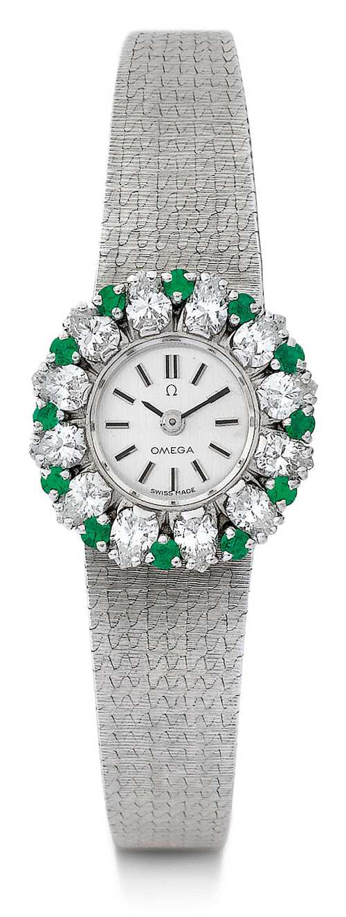 Omega, attractive diamond and emerald Lady's wristwatch.