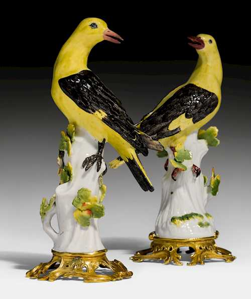 TWO MODELS OF ORIOLES WITH A GILT BRONZE MOUNT