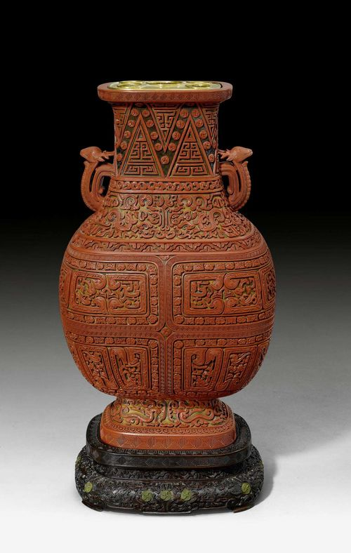 "AN IMPRESSIVE THREE COLOURED CARVED LACQUER VASE ""HU"". China, Qianlong period, height 71 cm (without stand). Nicely carved hardwood stand. Minor restorations. ***This item is subject to special bidding conditions, please let us know if you wish to bid on it***"