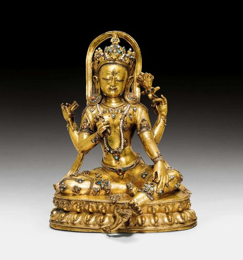 A MAGNIFICENT GILT COPPER FIGURE OF A FOUR ARMED GODDESS. Tibet, 14th/15th c. Height 30 cm. Very possibly from Densatil monastery. Unsealed. ***This item is subject to special bidding conditions, please let us know if you wish to bid on it***