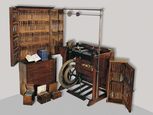 A RARE TURNING LATHE WITH A NUMEROUS TOOLS IN 2 LARGE AND 3 SMALL BOXES, by the company Holzappfel, London, 1824. Mahogany, cast iron, brass and steel. Pedal driven.