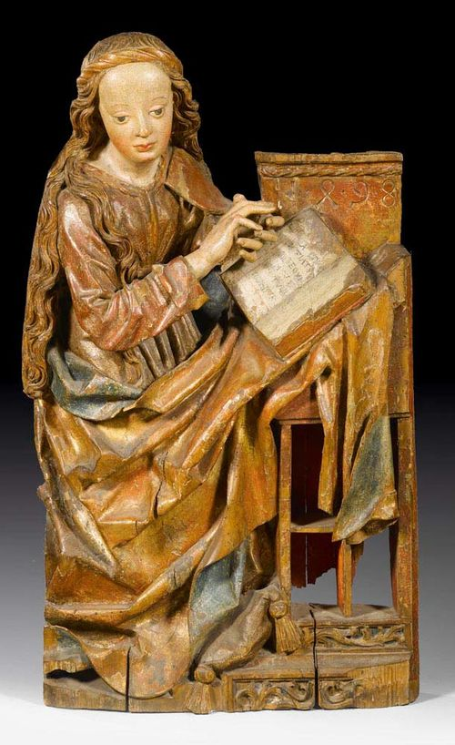 MARY FROM AN ANNUNCIATION GROUP,late Gothic, Franken, probably  Nuremberg, dated 1498. Carved linden wood, flat verso, painted and parcel gilt. H 104 cm. A finger and the paint partly restored.