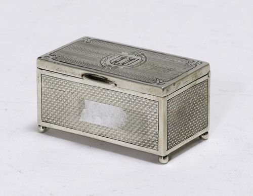 SMALL TOBACCO TIN,Austria after 1866. Maker's mark: MG. Chest-shaped. Engine-turned all around on four feet with a hinged cover. 6.5x3.5 cm, 59 g.